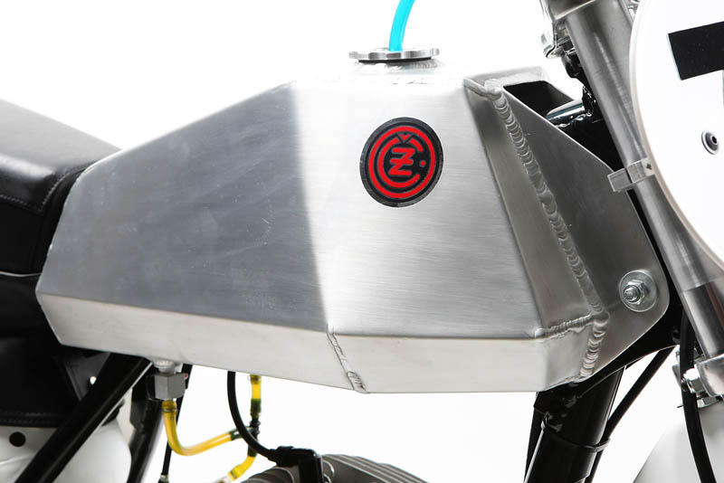 An aluminum coffin tank was added to the bike. Back in the 1970s, these tanks were used for motocross.