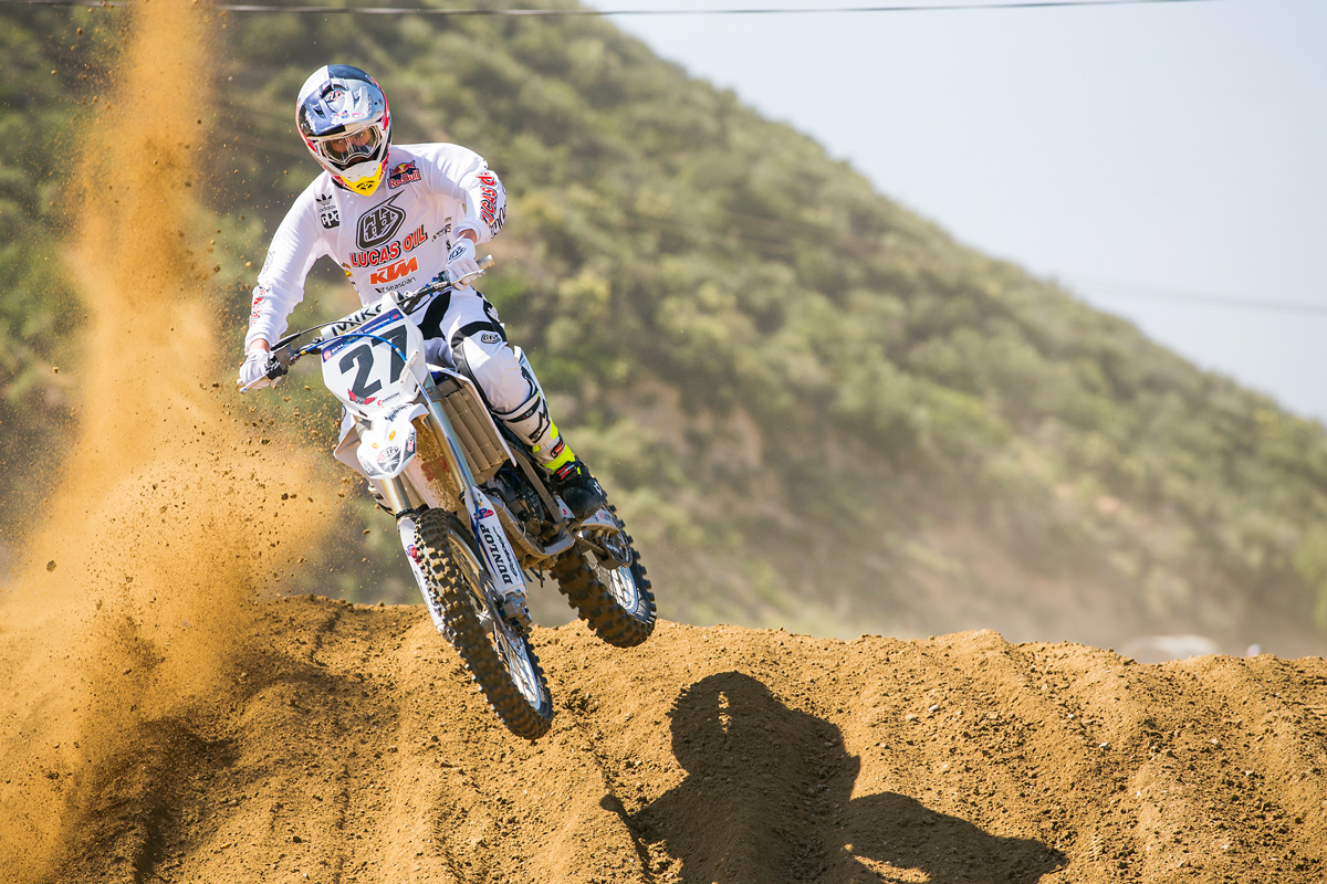 Justin dodging roost aboard his brother's YZ125.