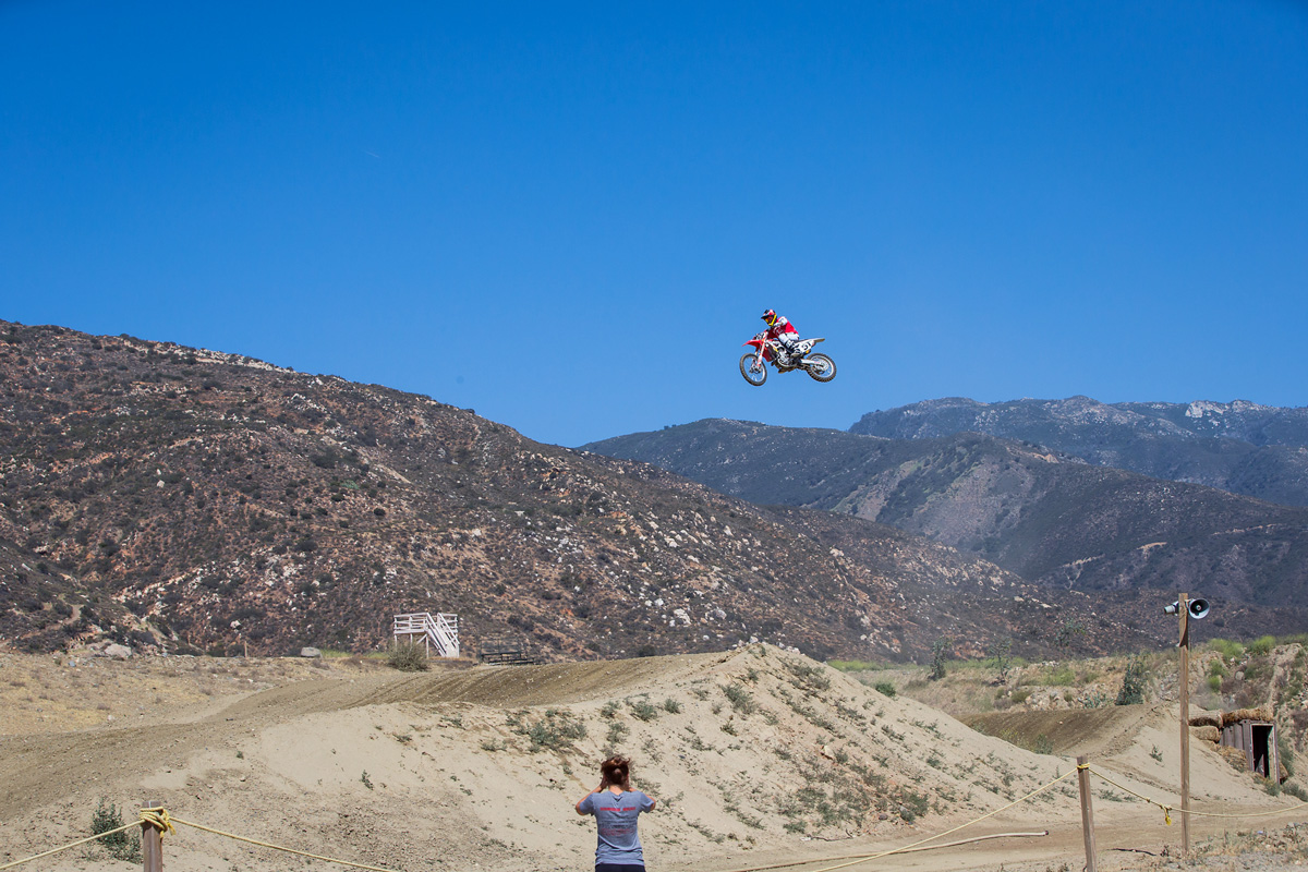 Ricky hucked this massive 150-foot quad a few times, leaving his bike with a few loose spokes and a flat spot on the frame...