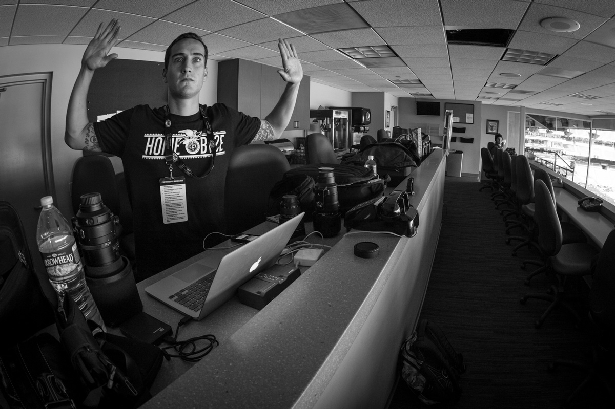 Mike Emery taking a break in the press box at Supercross.