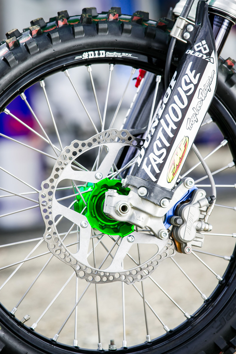 A Moto Stuff front brake rotor helps to bring the bike to a stop.
