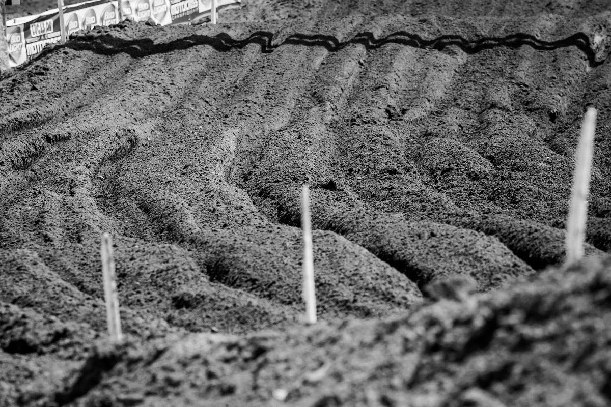 This photo was taken during practice. By the end of the day, these ruts were knee deep when walking through them.