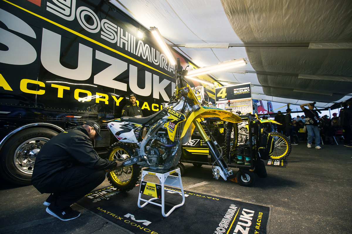 James Stewart's mechanic preps his bike before the night show begins.