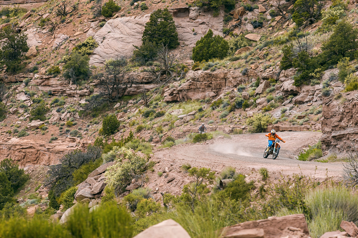 Justin Dawes leads Cameron Brewer up a Moab fire road.