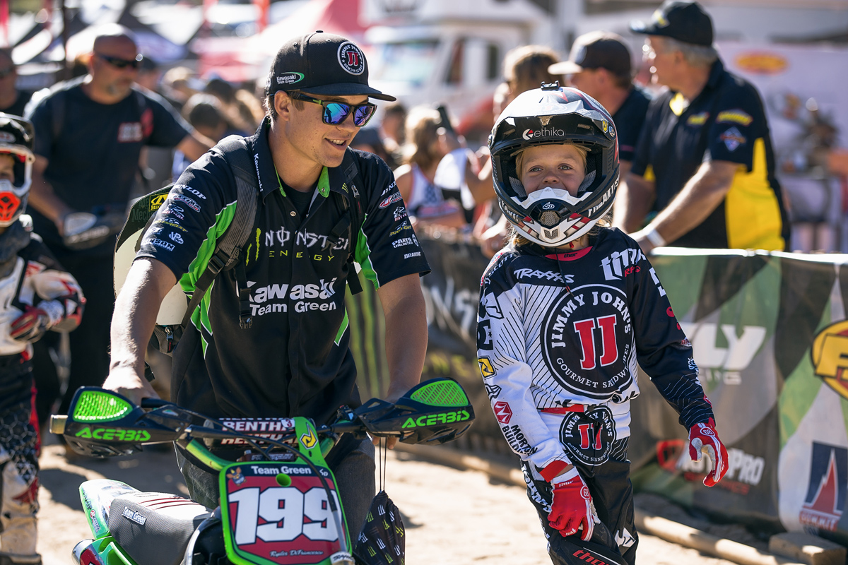 Ikua Hughes not only raced, but he also wrenched for young mini bike racer Ryder Difrancesco.