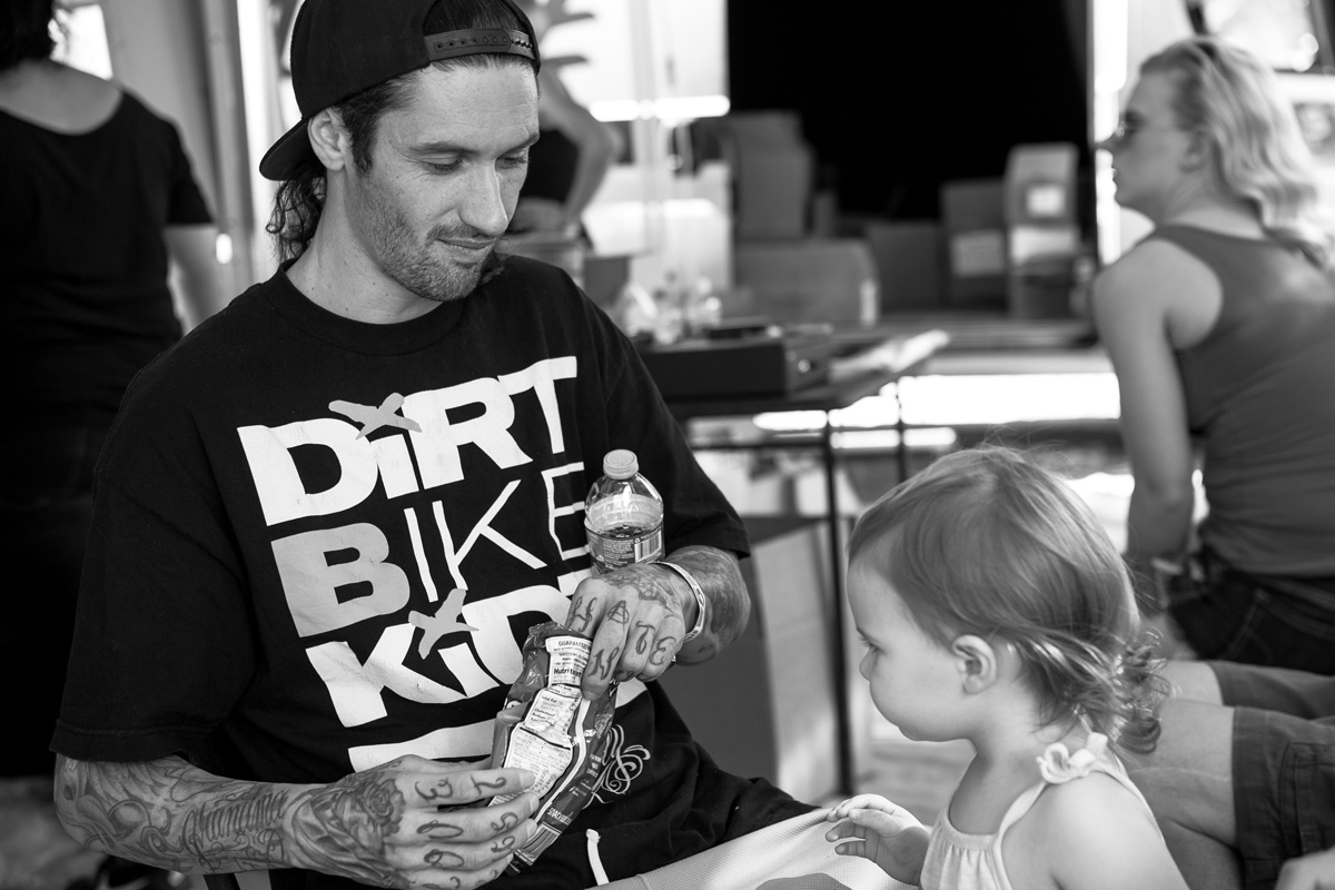Josh Hansen and his daughter escaping the heat and relaxing under the FH tent.